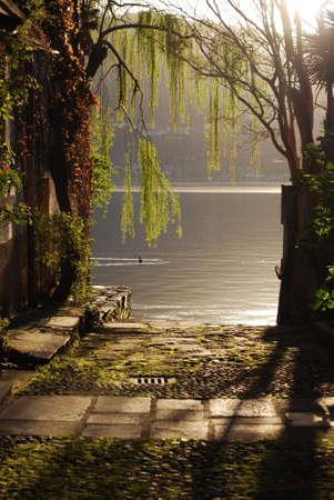 Sunset on Orta lake, Orta St. Giulio village, Piedmont, Italy Stock Photo