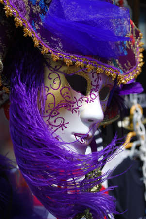 Typical colorful souvenir carnival mask in Venice, Italy photo