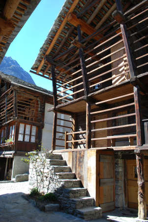Typical waltzer wooden chalet on Alps mountains, Alagna village, Piedmont, Italy photo