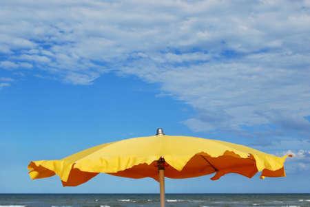 rimini: Yellow umbrella on the beach, Rimini, Italy