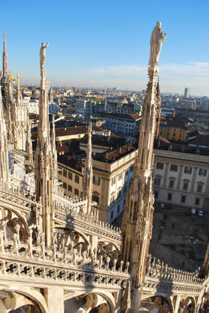 Landscape backview of Milan from Duomo cathedral roof, Royal Palace in background, Lombardy, Italy