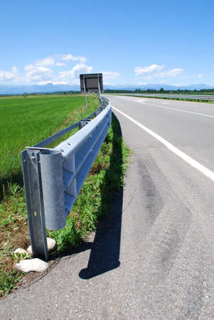 Guard rail on a road in countryside photo