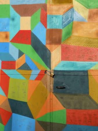 Metal padlock on locked bright colorful door as background Stock Photo - 11056062