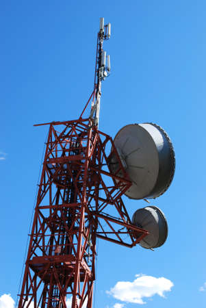 Huge communication antenna tower and satellite dishes against blue sky Stock Photo - 11056066