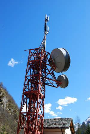 Huge communication antenna tower and satellite dishes against blue sky Stock Photo - 11056069
