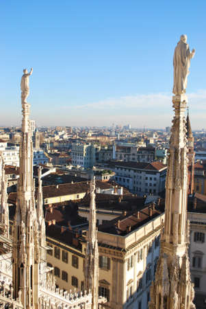 Landscape panoramic view of Milan from Duomo cathedral roof, Royal Palace in background, Lombardy, Italy Stock Photo
