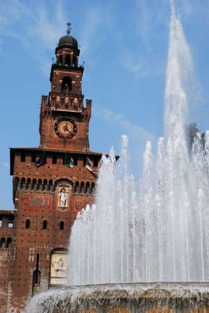 Sforza castle, main entrance at Filarete tower and fountain, Milan, Italy photo