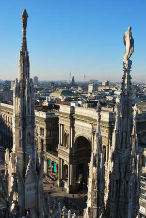 Landscape panoramic view of Milan from Duomo cathedral roof, Vittorio Emanuele gallery entrance in background, Lombardy, Italy photo