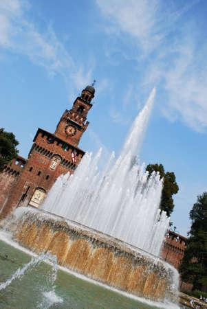 sforza: Sforza castle, main entrance at Filarete tower and fountain, Milan, Italy Stock Photo