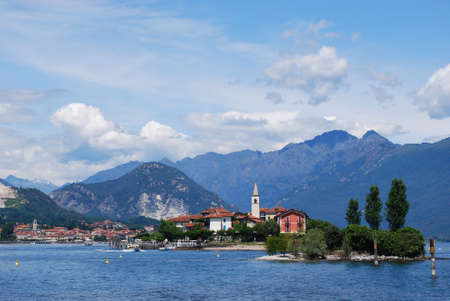 Panorama of Lake Maggiore and Fishermen Island with Alps mountains in background, Piedmont, Italy photo