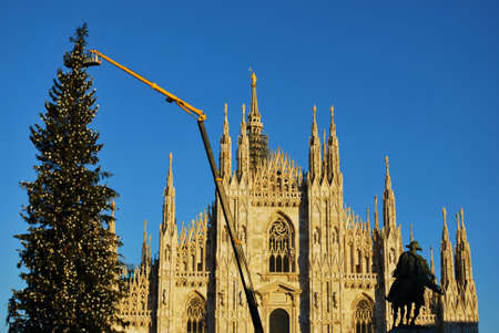 Gothic cathedral and christmas tree on blue sky, Milan, Italy Stock Photo