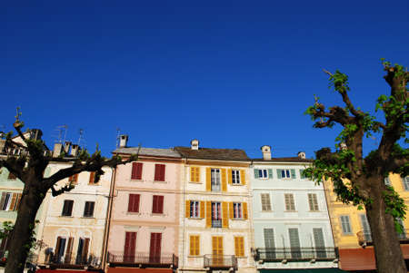 Colorful houses on blue sky in Orta St. Giulio village, Orta lake, Piedmont, Italy Stock Photo