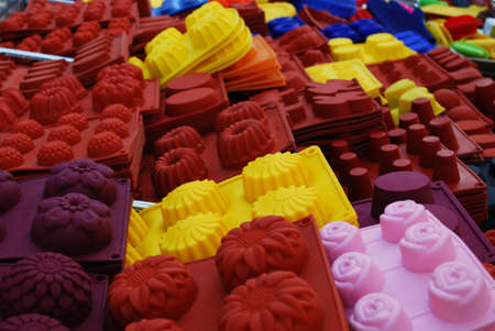 silicon: Colorful and differently shaped silicone baking pans as a background