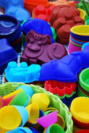 silicone: Colorful and differently shaped silicone baking pans as a background