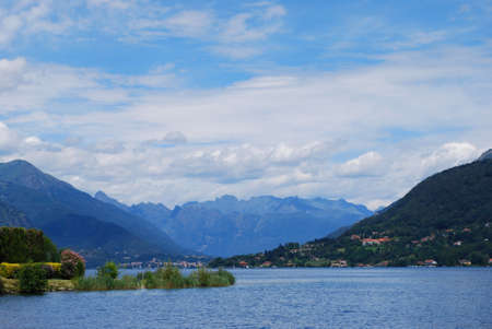 Panoramic view of Orta lake in summer with Alps mountains in background, Piedmont, Italy photo