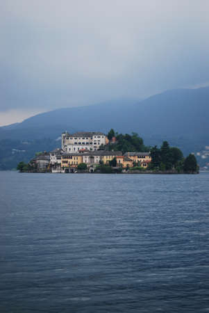 Orta St  Giulio island on Orta lake in an autumn day, Piedmont, Italy photo