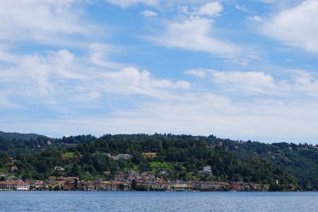 Panoramic view of Orta St  Giulio village on Orta lake in summer, Piedmont, Italy photo