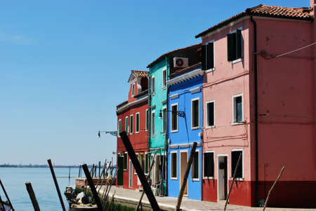 Colorful houses on the canals in Burano Island, Venice, Italy