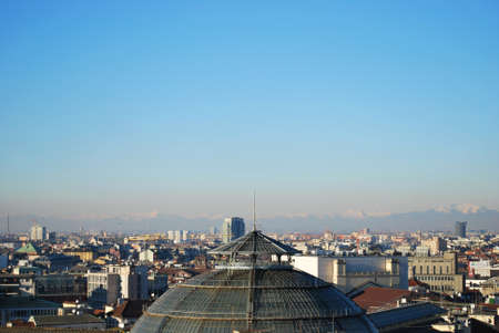 Cityscape panoramic view of Milan and Vittorio Emanuele gallery dome, from Duomo cathedral roof, Lombardy, Italy photo