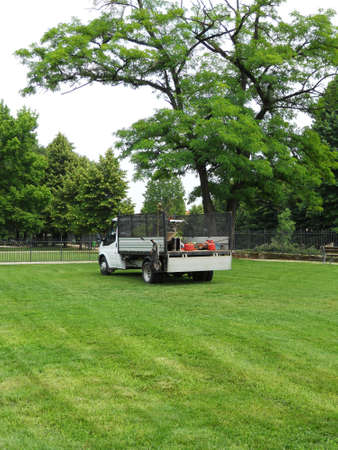 Truck gardener freshly cut grass