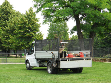 yard work: Truck gardener freshly cut grass