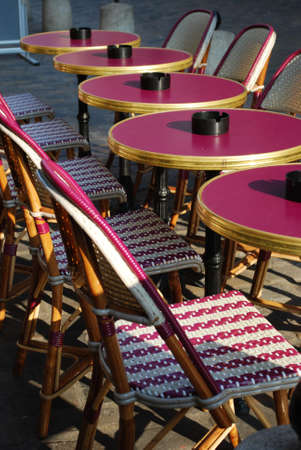 Typical outdoor cafe with tables and chairs on the sidewalk in Paris, France photo