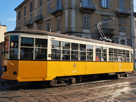 A symbol of the city, the old and traditional orange tram in Milan, Italy