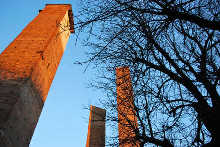 Medieval towers on blue sky at sunset, Leonardo Da Vinci square, Pavia, Lombardy, Italy