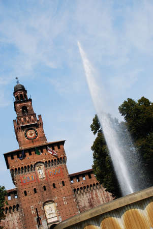 Sforza castle, main entrance at Filarete tower and fountain, Milan, Italy