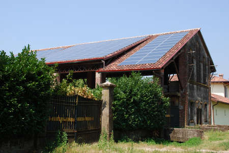 Solar panels on the roof of a farm for ecologic energy photo