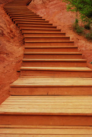 Wooden stair in the red ochre park, Roussillon, Provence, France photo