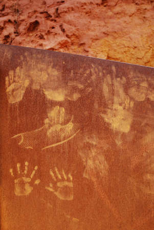 Ocher handprints background, Roussillon village, Provence, France