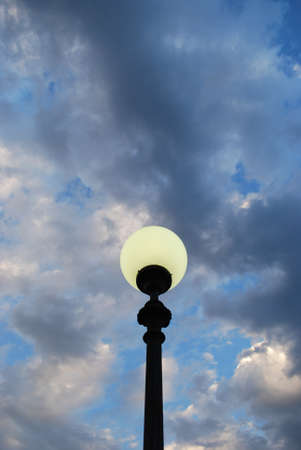Street lamp at dusk on blue cloudy sky background Stock Photo - 19031991
