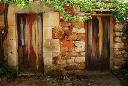 Two colorful painted doors in ocher village of Roussillon, Provence, France photo