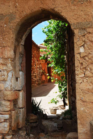 Houses behind an arc in historical ocher village of Roussillon, Provence, France Stock Photo