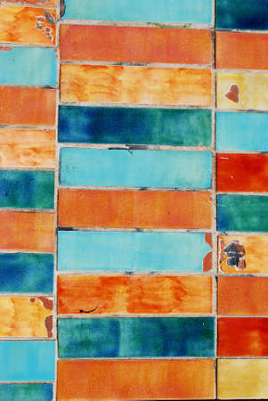 Vintage colorful damaged tiles background texture photo