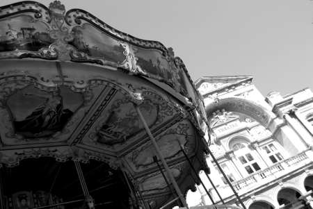 Black and white picture of vintage carousel and theater in Avignon, Provence, France