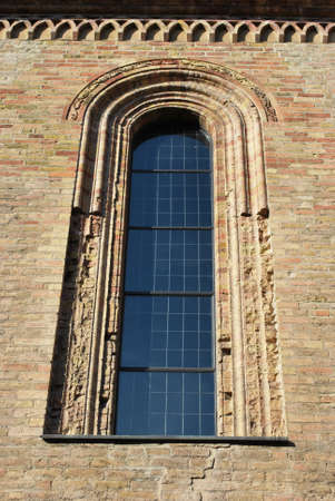 Romanesque cathedral window detail, Crema town, Lombardy, Italy