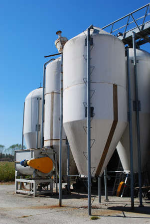 Group of small silos for storing grain in a farm photo