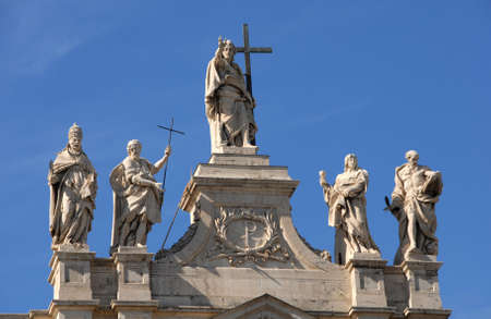 Jesus among popes, saints, and apostles at the top of Saint John Basilica in Rome