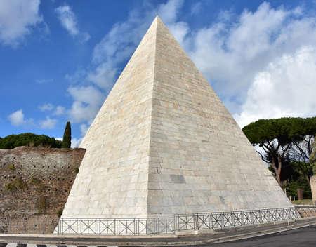 pyramid: Ancient Pyramid of Cestius with beautiful sky Stock Photo