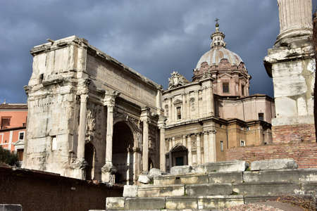 church dome: Ancient Arch of Septimius Severus and baroque Church of Saint Luca e Martina viewed from the Roman Forum
