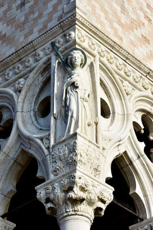 saint mark square: Relief of Archangel Michael at the corner of the Doges Palace in Saint Mark Square