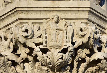 saint mark square: Medieval reliefs from Doges Palace capital in Saint Mark Square, with Creation of Adam Stock Photo