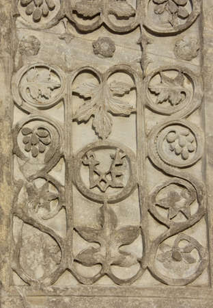 saint mark square: Detail of the ancient Acre pillar with sassanid motif, right in center of Saint Mark Square in Venice Stock Photo