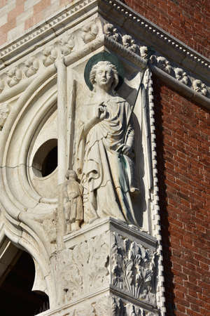medieval medicine: Sculputure of Archangel Raphael with Tobias at the corner of Doges Palace in Venice