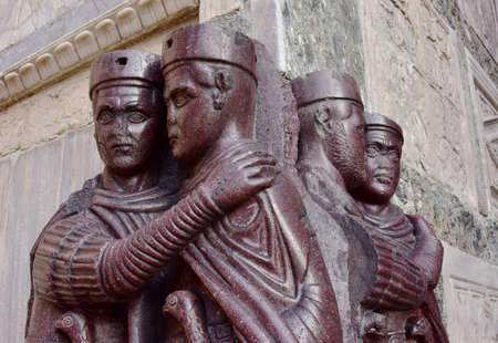 emperors: Detail from Monument of Four Tetrarchs, late roman emperors, at the corner of Saint Mark Basilica in Venice Editorial