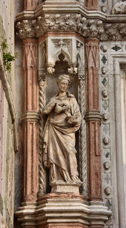 by virtue: Statue of Temperance virtue from Porta della Carta gate in Saint Mark Square, Venice Stock Photo