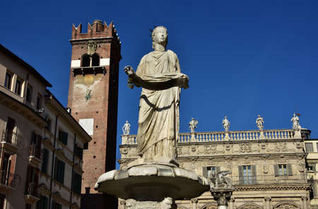 saint marks: Madonna Verona fountain, the city symbol, with Gardello Tower, Palazzo Maffei and Saint Marks Lion in the background, in Piazza delle Erbe square