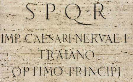 spqr: The Emperor Trajans monument pedestal in the Imperial forum with latin inscription: S.P.Q.R, Emperor Caesar Nerva Trajan, the best ruler
